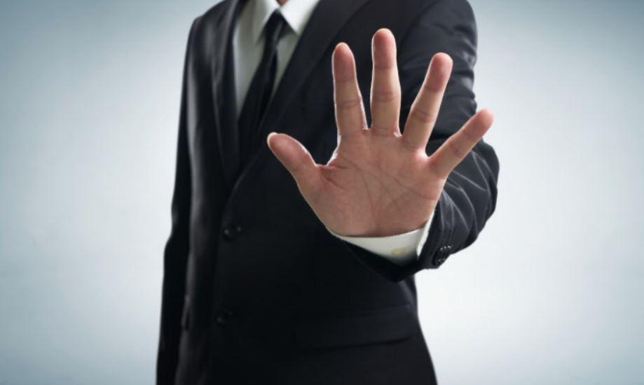 hand placed in front of man